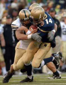 {071201-N-6463B-543} -- Baltimore, MD. (Dec. 1, 2007) -- CAPTION Navy Quarter Back Troy Gross gets sacked by a blitzing Army defender at the 108th annual Army vs. Navy football game at M&T Bank Stadium in Baltimore, MD. The Navy defeated the Black Knights of Army with a score of 38-3. The Navy Midshipmen have now won the past six Army Navy battles. The 8-4 Midshipmen have accepted an invitation to play in the Poinsettia Bowl in San Diego, Ca on Dec. 20th. SLUG LINE U.S. Navy Photo by Mass Communication Specialist 2nd Class (SW/AW) Herbert D. Banks Jr. (RELEASED)
